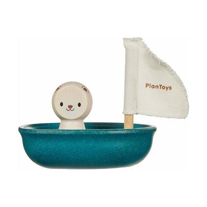 Белый медведь в лодке